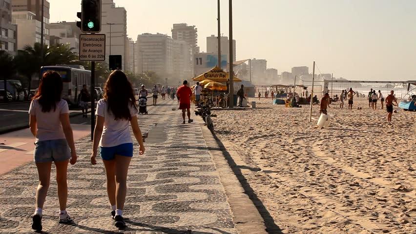 May 5, Rio de Janeiro. People enjoying the sunny day at the Leblom Beach in Rio de Janeiro, one of most popular beaches in Rio de Janeiro. Full HD, 1080p.