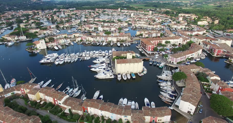 2015 High Quality Aerial Video (Ultra HD) of Port Grimaud in the French Riviera near St. Tropez. Also known as 'Venice in France' because of the many canals and boats. Camera pan left.