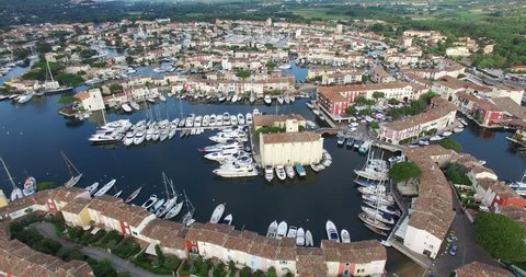HQ Aerial Drone Video (Ultra HD) of Port Grimaud in the French Riviera near St. Tropez. Also known as 'Venice in France' because of the many canals and boats. Camera pan left.