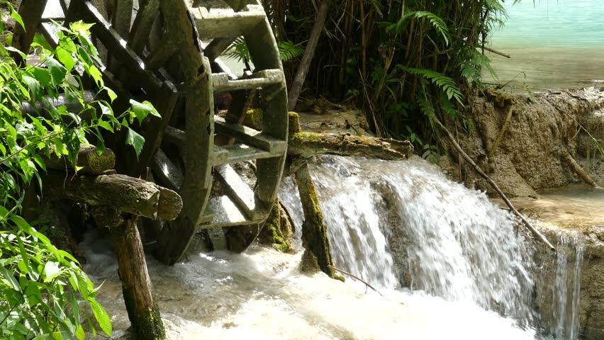 Old wooden water wheel at Kuang Si waterfall (sometimes spelled Kuang Xi) or known as Tat Kuang Si Falls, South of Luang Prabang, Laos.