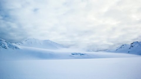 Spring in Arctic. Amazing clouds over the mountains of Spitsbergen.