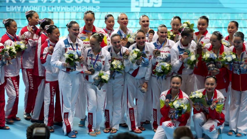 KAZAN, RUSSIA - 29 July 2015: FINA World Championships. Champions in synchronized swimming: Chinese team - a silver medal, the Russian team - gold medal, Japanese team - a bronze medal.