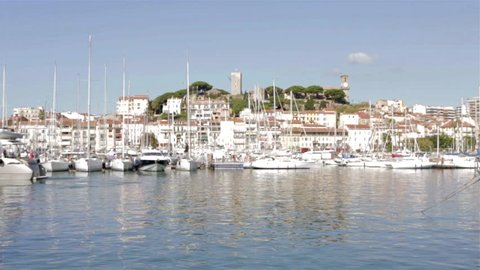 CANNES, FRANCE - AUGUST 17, 2015: View at Cannes from the harbour, city in the background. Cannes is one of the bigest French tourist cities.