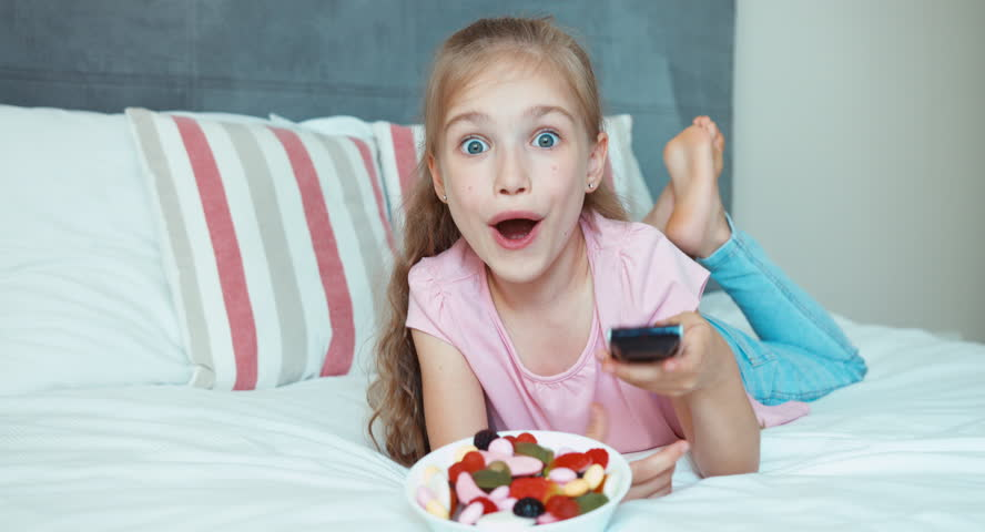Girl Watching Tv Lying On The Bed Child Shocked Tv Stock Footage Video 11394065 -7737