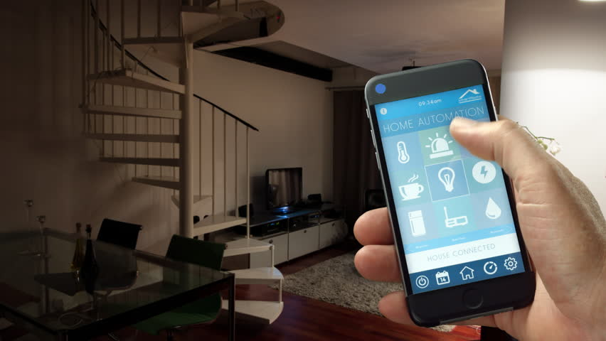 Smart Home - smart house, home automation, device with app icons. Man uses his smart phone with smarthome security app to turn on the lights of his house. (Shot on RED) | Shutterstock HD Video #11405453