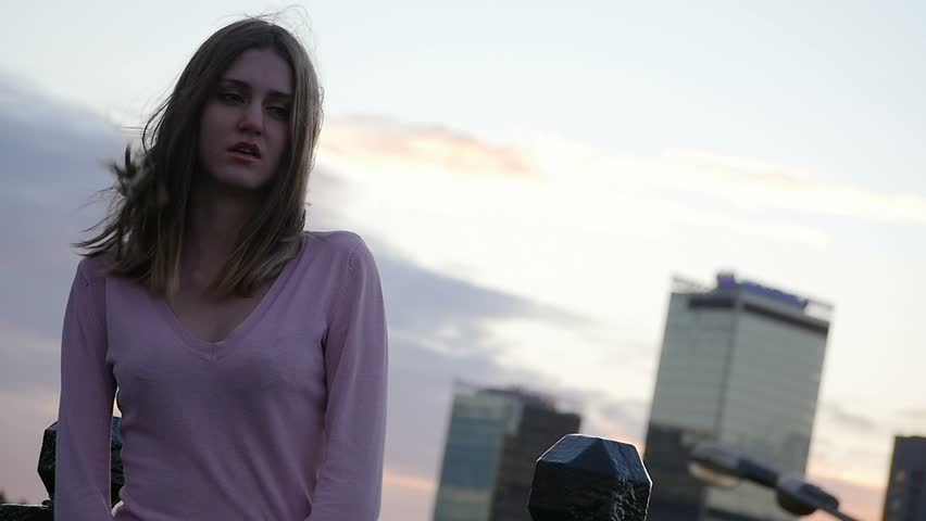 Upset depressed unhappy girl aimlessly standing alone. Middle shot. Slow motion. | Shutterstock HD Video #11414033