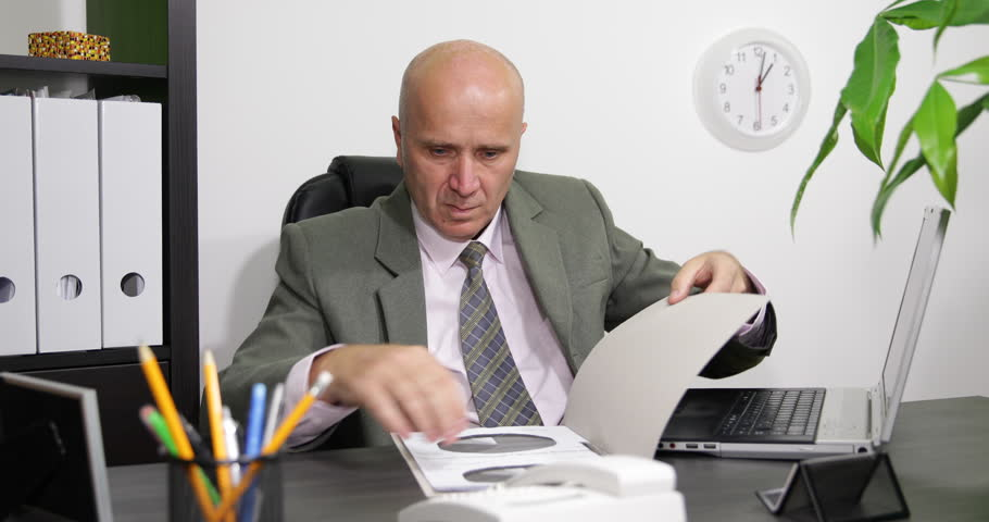 Businessman Job In Office Room Checking Documents And Write Data In ...