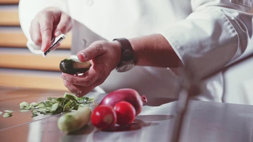 Restaurant Kitchen Hand close-up of chef hands cooking and preparing in restaurant kitchen