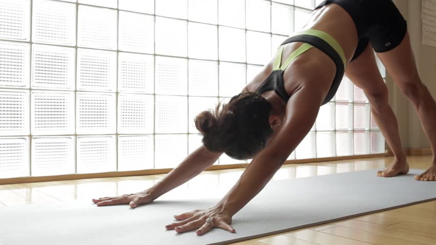 Woman practicing yoga in a studio indoors