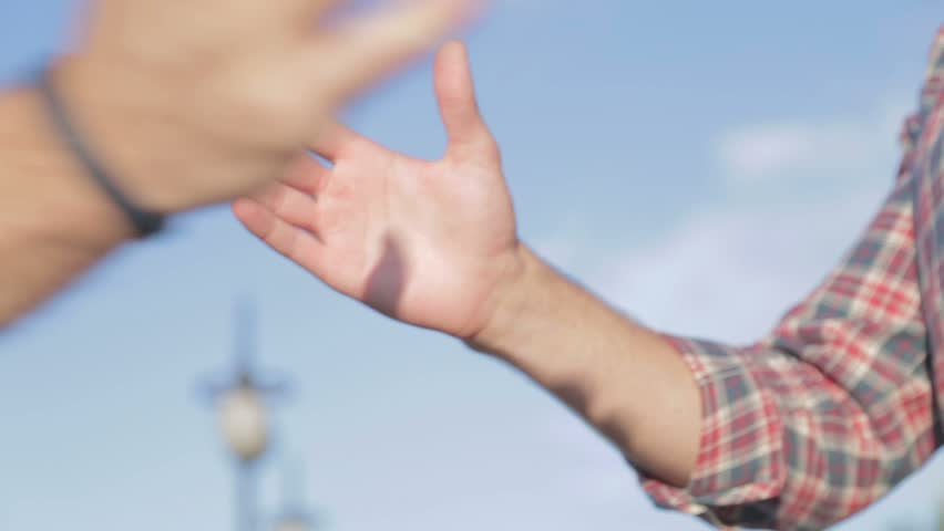 Shaking hands between friends. Friendship handshake outdoor. Two good guys are shaking hands and fists when meeting. | Shutterstock HD Video #11448617