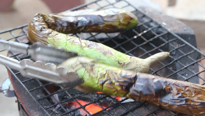 Baking eggplant on a grill with charcoal in Thailand | Shutterstock HD Video #11453063