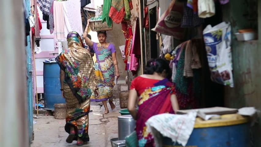 MUMBAI, INDIA - 12 JANUARY 2015: Women passing through a street in Mumbai.