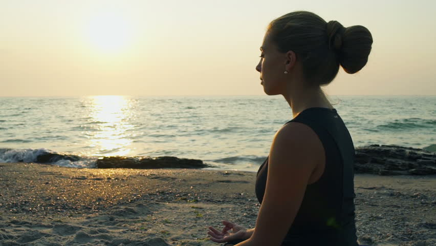 Young meditating female on the beach slow motion | Shutterstock HD Video #11479583
