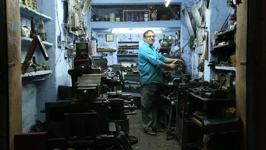 Image result for working at machine workshop