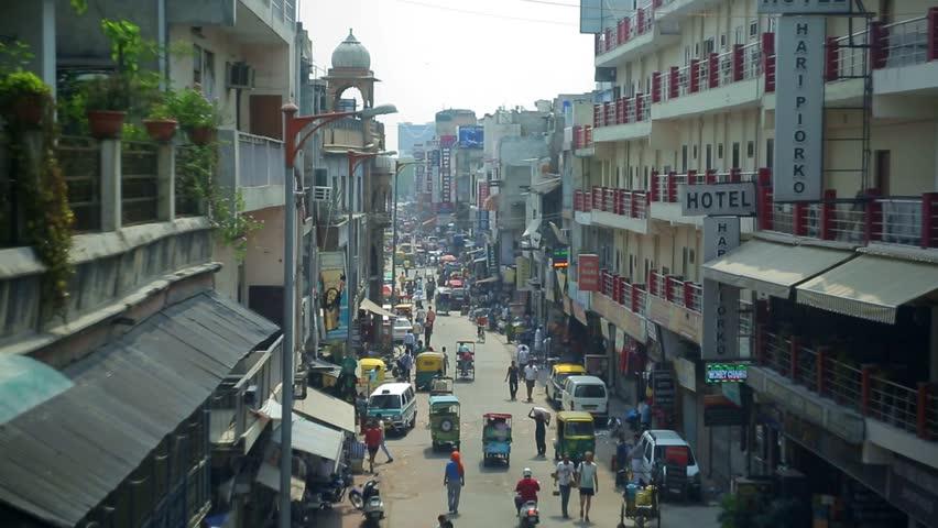 New Delhi, INDIA - June 18-14: Day view of Main bazar Pahar Ganj street in Delhi. People, cars, motorbikes and auto rickshaws on the street n New Delhi on June 18-14 | Shutterstock HD Video #11483432