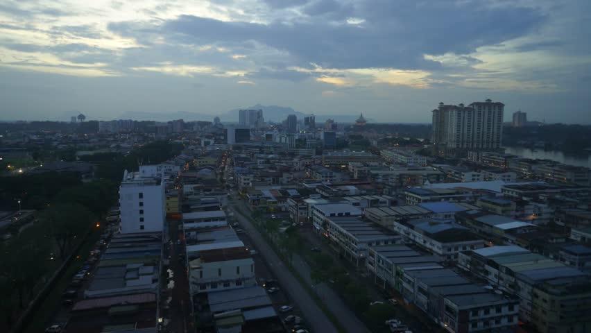 Time lapse of Kuching Sarawak Malaysian Borneo cityscape from sunset to night after rain.