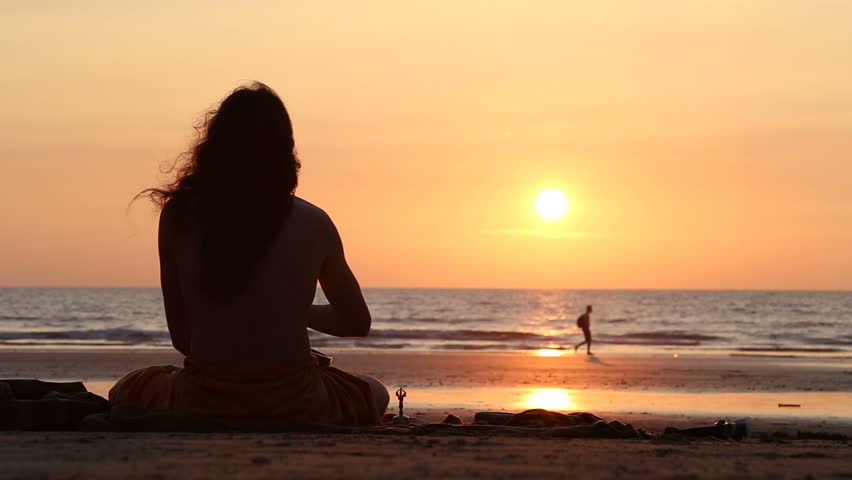 GOA, INDIA - 21 JANUARY 2015: Man Sitting On Beach At Sunset Playing Music To The Sun. Stock Footage Video 11500823 | Shutterstock