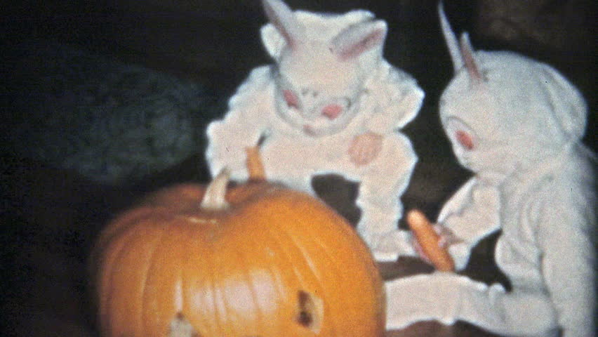 BOULDER, COLORADO 1951: Creepy Halloween kids bunny costumes.