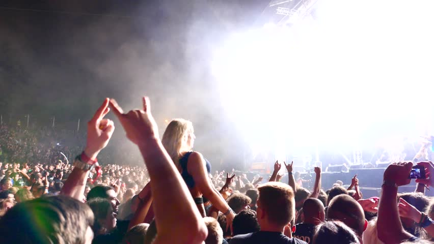 TOLMIN, SLOVENIA - JULY 24: Crowdsurf on the live performance of the famous Swedish thrash metal band, Arch Enemy at the Metaldays festival on July 24, 2015 in Tolmin, Slovenia.