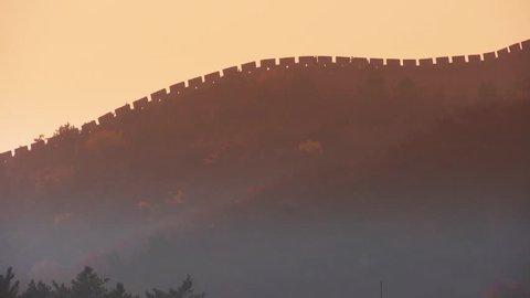 Great Wall on mountain peak hill ridge & Battlements shadow silhouette in mist. gh2_05823