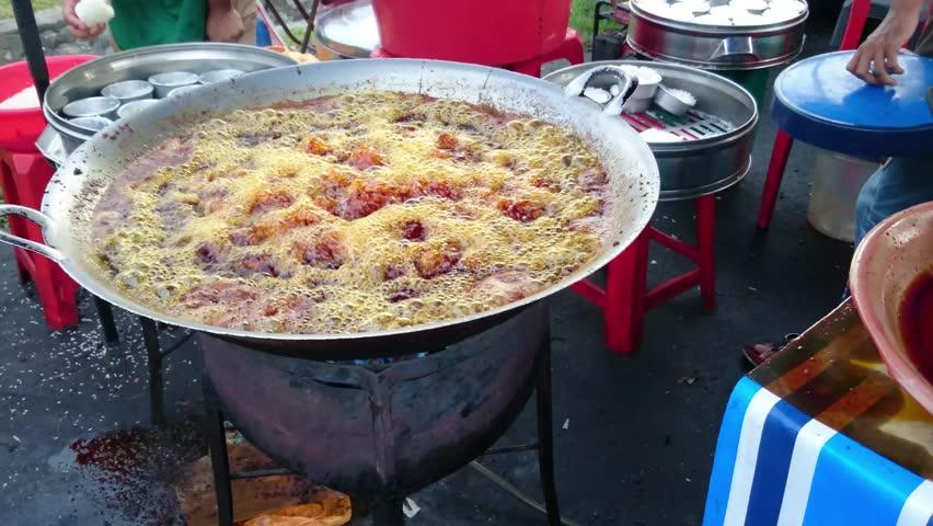 "Frying Chicken In Big Pan At Malaysia's ""Pasar Malam"" or Night Market"
