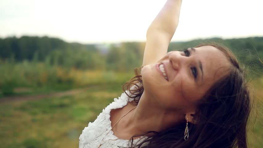Slowmotion of happiness young beautiful brunette woman raises her arms outdoor under sunlight of sunset spinning around, dancing and singing. 1920x1080 | Shutterstock HD Video #11580683