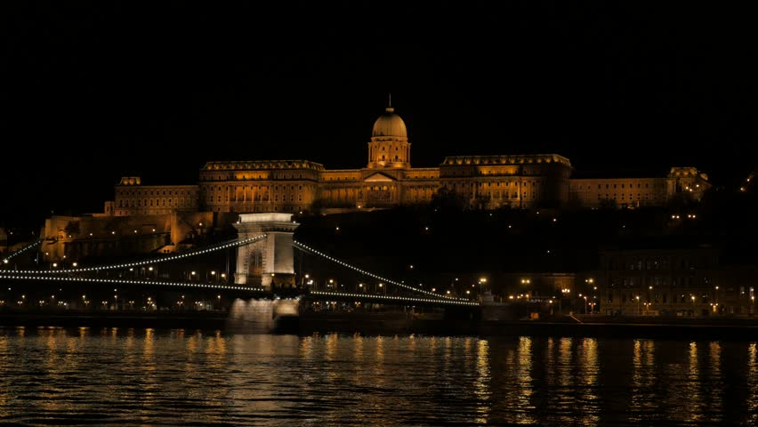 Famous Szechenyi bridge and royal palace on Buda hill Budapest 4K 2160p UltraHD footage - Chain Bridge located in Hungarian capital of Budapest lighted by night 4K 3840X2160 UHD video | Shutterstock HD Video #11585123