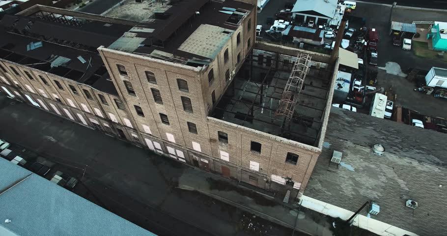 Flying over abandoned factory/warehouse | Shutterstock HD Video #11594543