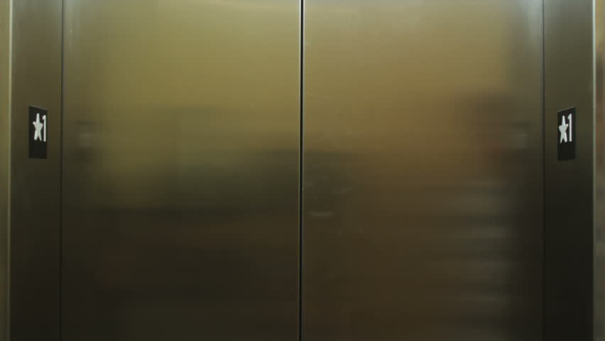 man playing a joke in an elevator - HD stock video clip & Elevator Is Arriving And Doors Open Automatically Blue Tone Stock ... pezcame.com