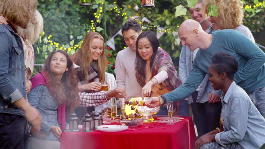4K Freshly cooked food from the bbq is served to friends at outdoor social gathering. Shot on RED Epic. | Shutterstock HD Video #11616803