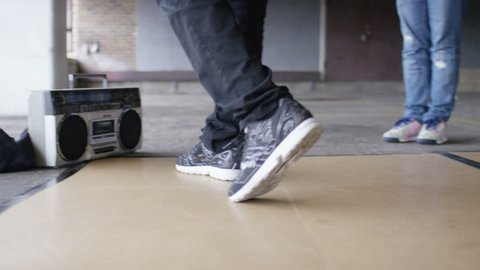 4K Close up of male breakdancers feet as he moonwalks and dances, shot on Red Epic Dragon