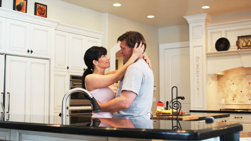 Couple Standing In The Kitchen Kissing Stock Footage Video ...