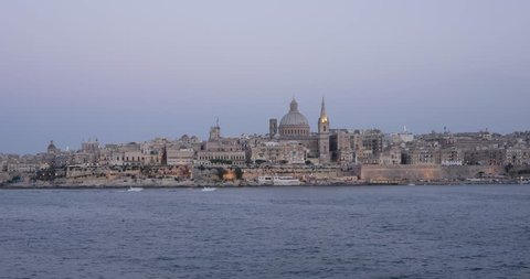 Time-lapse of evening view of Valetta, capital of Malta with fireworks, 4k