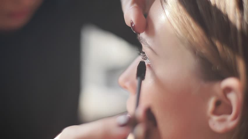 Professional mascara makeup application with brush working in beauty fashion industry cosmetics backstage professional make-up - side view hand tool macro close-up beautiful natural lighting | Shutterstock HD Video #11745155