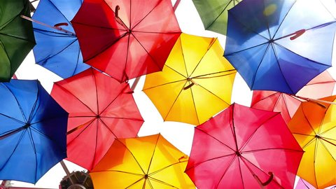 Colorful umbrellas open in the sky as a decoration in London city