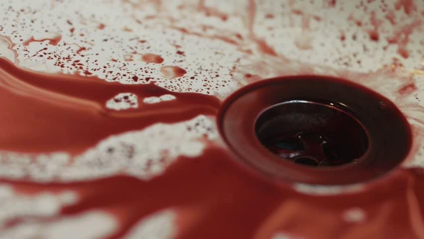 Washing Blood Away in Sink - Close Up