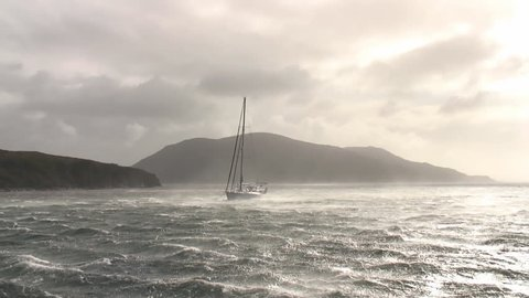Sailing boat in stormy weather