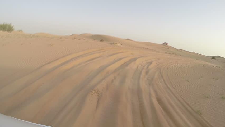 DUBAI, UNITED ARAB EMIRATES - MAY 12, 2014:4x4 off road land vehicle taking tourists on desert dune bashing safari, Middle East