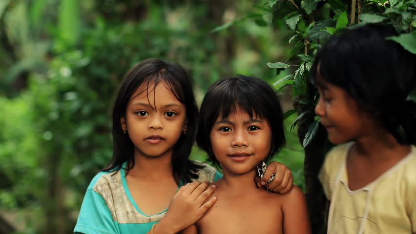 Three native Balinese girls posing playful for camera, changing places, laughing and having fun | Shutterstock HD Video #1191103