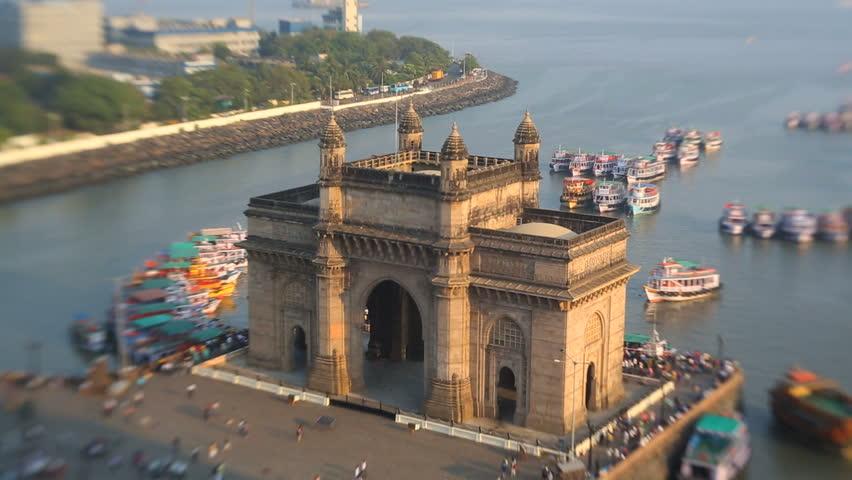 India - March 2015: Mumbai India Gateway India Maharashtra Asia monument Lens baby vessel building sea city people harbour