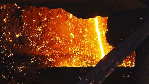 Molten metal melted in furnace at metallurgical plant