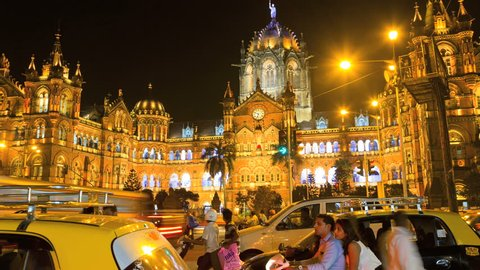 India - March 2015: Mumbai Asia time lapse Chhatrapati Shivaji Terminus CST illuminated night rail tours Unesco traffic travel
