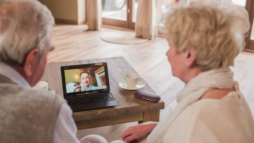 Grandparents thumbs up to grandson over video call 4K. Two elderly person using new technology live video call with laptop computer and talking to grandson over-sea about football achievements.    Shutterstock HD Video #11954993