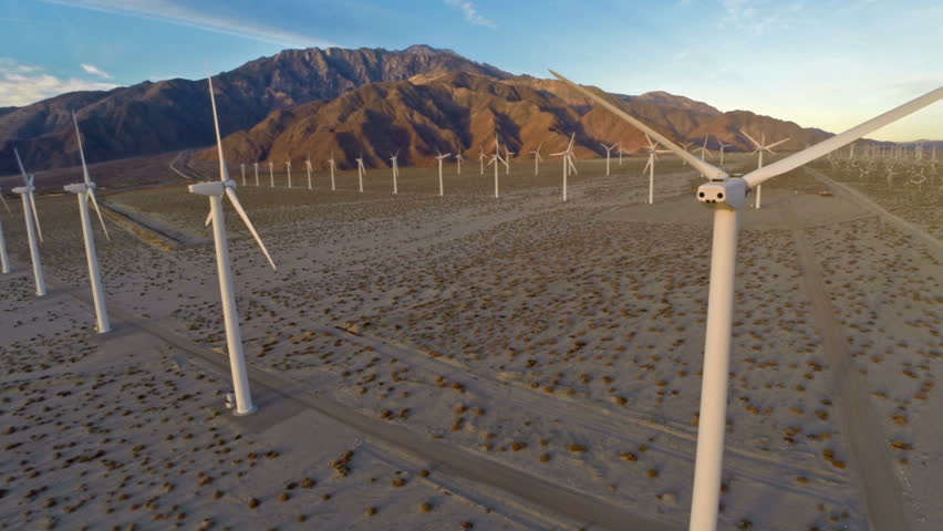 Aerial video of Windmills at sunrise in California.