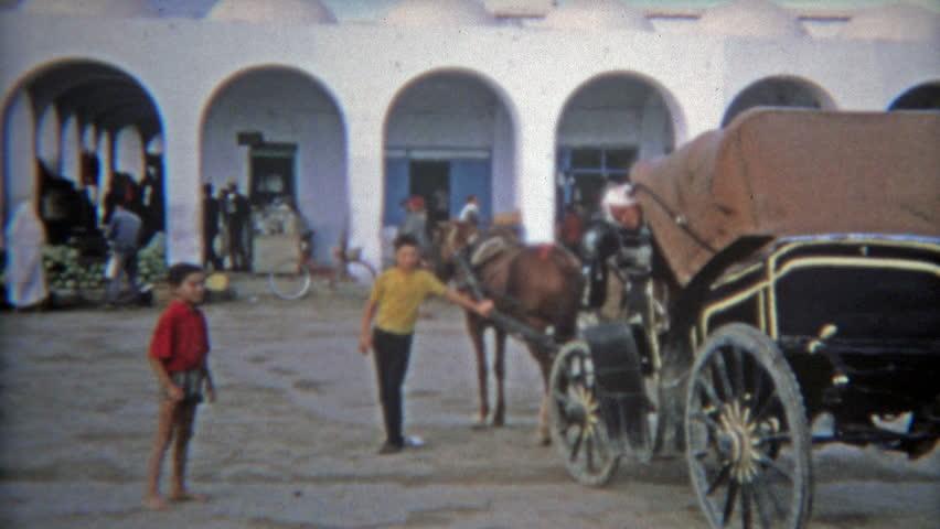 TUNIS, TUNISIA 1972: Tunisian marketplace hustle and bustle of Arab port city.