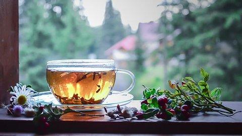 A cup of hot tea on a windowsill.