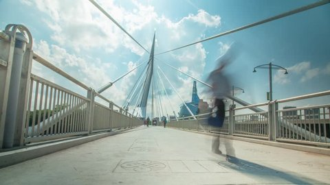 Beautiful Winnipeg Time lapse of pedestrians passing over the iconic Provencher Bridge with the Human Rights Museum in the background on Sunny Day.