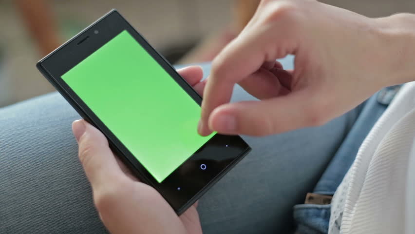 Woman hands touching and scrolling smartphone.green screen display | Shutterstock HD Video #12004040