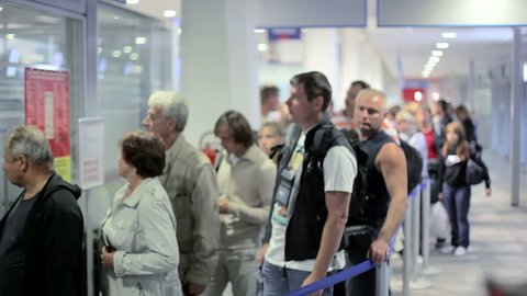 MONTENEGRO - PODGORICA 2012 - Passengers  waiting in line for buying tickets at the airport counter