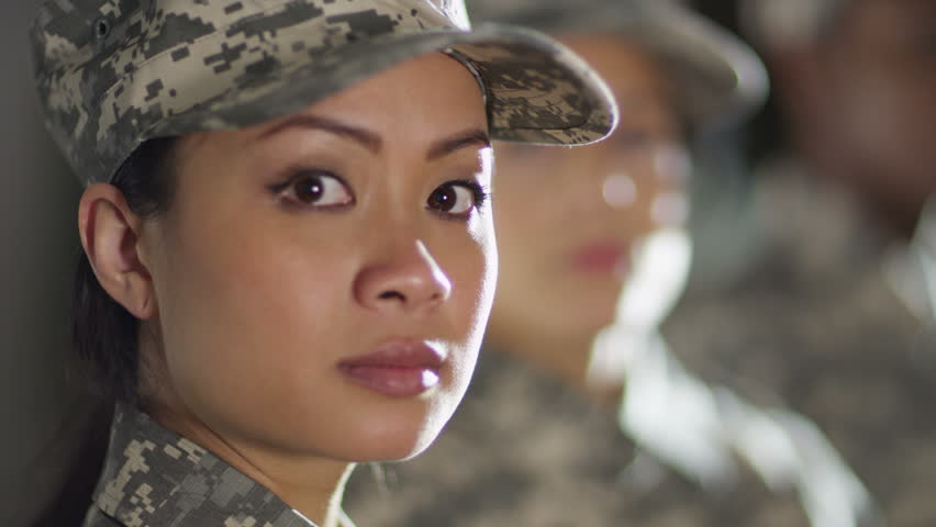4K Close up on faces of mixed ethnicity female soldiers standing to attention. Shot on RED Epic.
